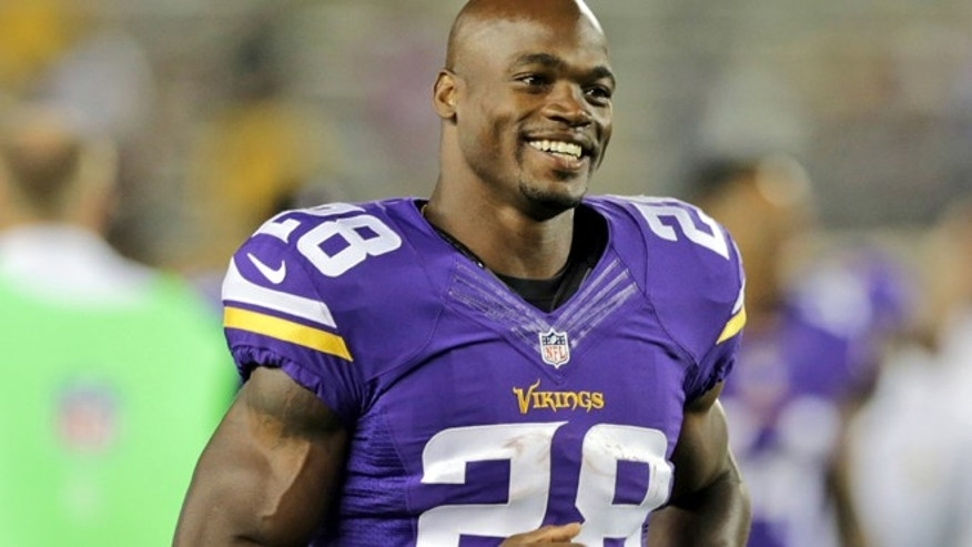 FILE 2014:  Minnesota Vikings running back Adrian Peterson leaves the field after an NFL preseason football game against the Oakland Raiders in Minneapolis.