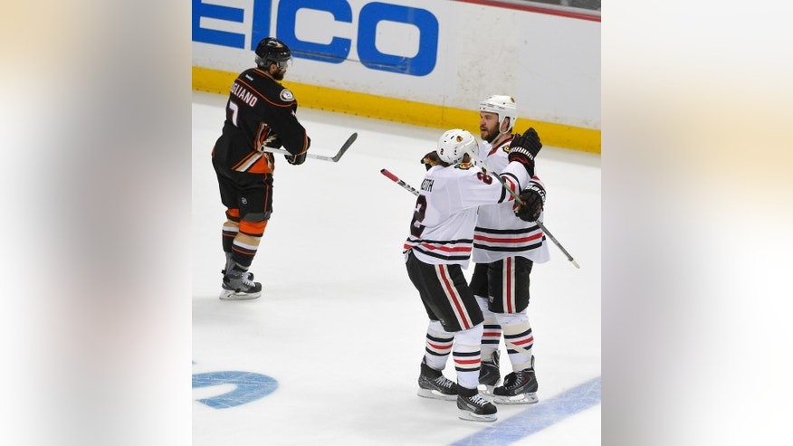 Chicago Blackhawks defenseman Brent Seabrook, right, celebrates after scoring with Duncan Keith during the third period in Game 7 of the Western Conference final of the NHL hockey Stanley Cup playoffs against the Anaheim Ducks in Anaheim, Calif., Saturday, May 30, 2015.  (AP Photo/Mark J. Terrill)