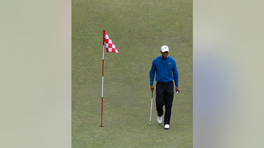 Tiger Woods walks past the flag as he practices on the ninth green, Tuesday, June 2, 2015, at Chambers Bay in University Place, Wash., where the U.S. Open will be played June 18-21. (AP Photo/Ted S. Warren)