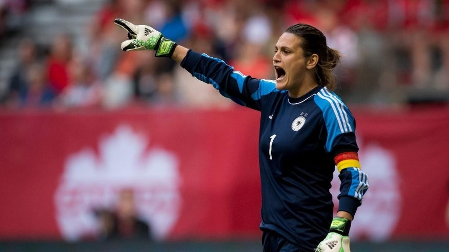 FILE - In this June 18, 2014, file photo, Germany's goalkeeper Nadine Angerer calls out instructions to her teammates during the first half of an international friendly soccer game against Canada in Vancouver, British Columbia. Angerer anchors a German team that appears to be in flux. (AP Photo/The Canadian Press, Darryl Dyck, File)