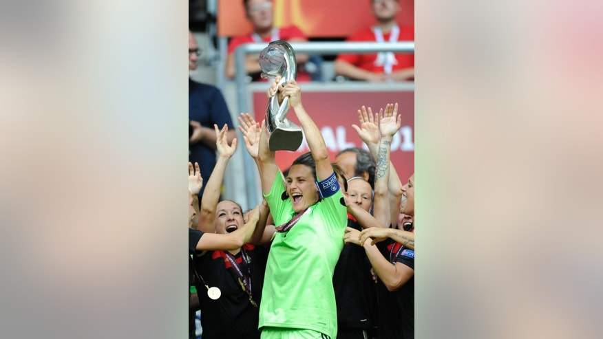 FILE - In this July 28, 2013, file photo, Germany's goalie Nadine Angerer holds the trophy after their 1-0 victory in the UEFA Women's Euro soccer final against Norway at the Friends Arena in Stockholm, Sweden. Angerer anchors a German team that appears to be in flux. (Soren Andersson,/Scanpix Sweden via AP, File)   SWEDEN OUT