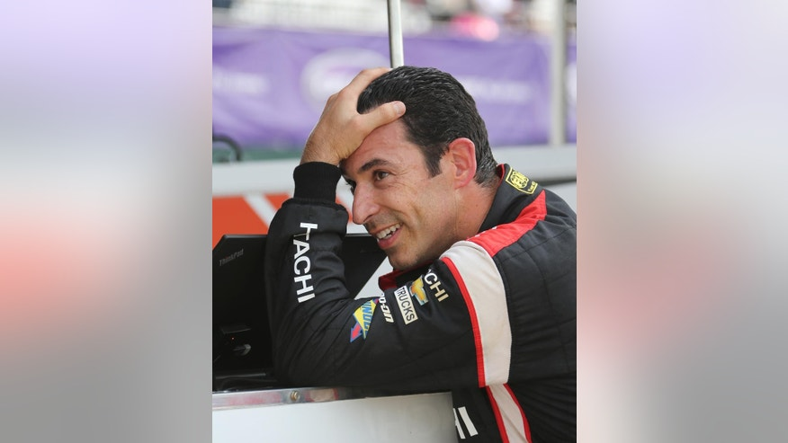 Helio Castroneves reacts after qualifying second for the first race of the IndyCar Detroit Grand Prix auto racing doubleheader Friday, May 29, 2015, in Detroit. Castroneves missed the pole position to teammate Will Power. (AP Photo/Bob Brodbeck)