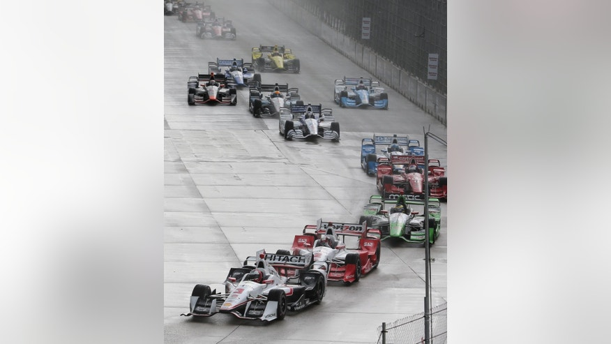 Helio Castroneves leads the field during the first race of the IndyCar Detroit Grand Prix auto racing doubleheader Saturday, May 30, 2015, in Detroit. (AP Photo/Dave Frechette)