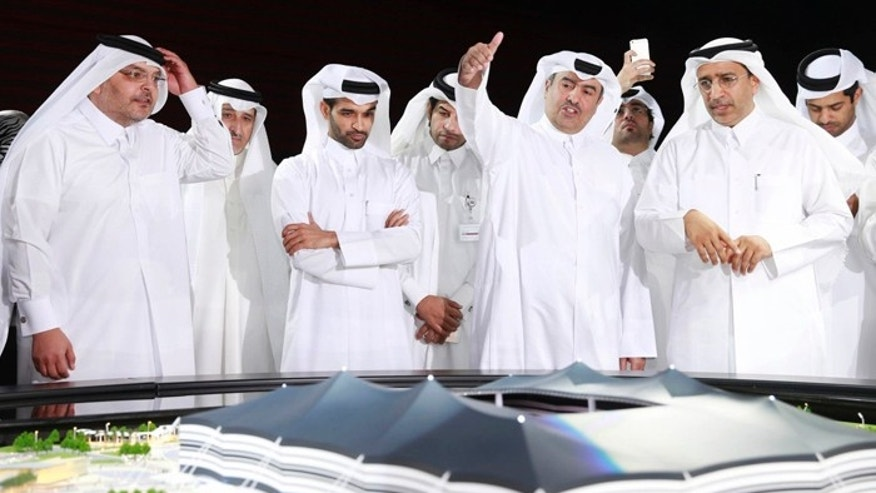 Qatar's 2022 World Cup organizing committee, shown here, has been accused of paying FIFA officials to win the bid to host the games, which would be played in the fall and winter due to hot weather. (Reuters)