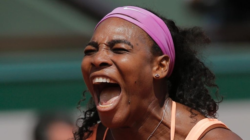 Serena Williams of the U.S. celebrates winning the quarterfinal match of the French Open tennis tournament against Italy's Sara Errani in two sets 6-1, 6-3, at the Roland Garros stadium, in Paris, France, Wednesday, June 3, 2015. (AP Photo/Christophe Ena)