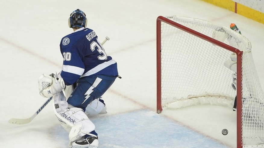 Tampa Bay Lightning goalie Ben Bishop (30) watches as Chicago Blackhawks left wing Teuvo Teravainen's  score a goal during the third period in Game 1 of the NHL hockey Stanley Cup Final in Tampa, Fla., Wednesday, June 3, 2015.  The Blackhawks defeated the Lightning 2-1. (AP Photo/Phelan M. Ebenhack)
