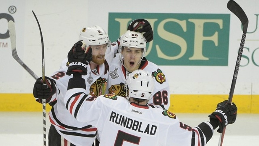 June 3, 2015: Chicago Blackhawks left wing Teuvo Teravainen (86), celebrates his goal with Duncan Keith (2) and David Rundblad (5) during the third period in Game 1 of the NHL Stanley Cup Final against the Tampa Bay Lightning in Tampa, Fla. (AP Photo/Phelan M. Ebenhack)