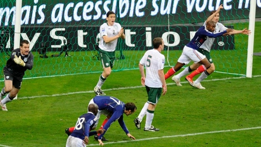 Nov. 18, 2009: Ireland's goalkeeper Shay Given (L) reacts after controversial goal by France's William Gallas (2nd R) where team captain Thierry Henry touched the ball during their World Cup qualifying playoff match at the Stade de France stadium in Saint-Denis near Paris. (Reuters)