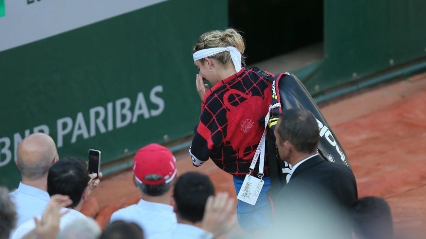 Timea Bacsinszky of Switzerland leaves the court after losing to Serena Williams of the U.S. during their semifinal match of the French Open tennis tournament at the Roland Garros stadium, Thursday, June 4, 2015 in Paris. Williams won 4-6, 6-3, 6-0.   (AP Photo/David Vincent)