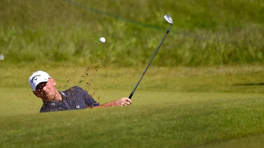 Denmark's Thomas Björn plays from the bunker on hole 12 during the Nordea Masters golf tournament at the PGA National golf course outside Malmo, Sweden, Friday, June 5, 2015. (Anders Wiklund / TT via AP)  SWEDEN OUT