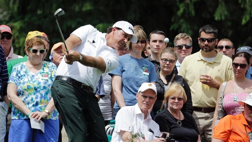 Phil Mickelson hits to the sixth green during the first round of the Memorial golf tournament, Thursday, June 4, 2015, in Dublin, Ohio. (AP Photo/Darron Cummings)