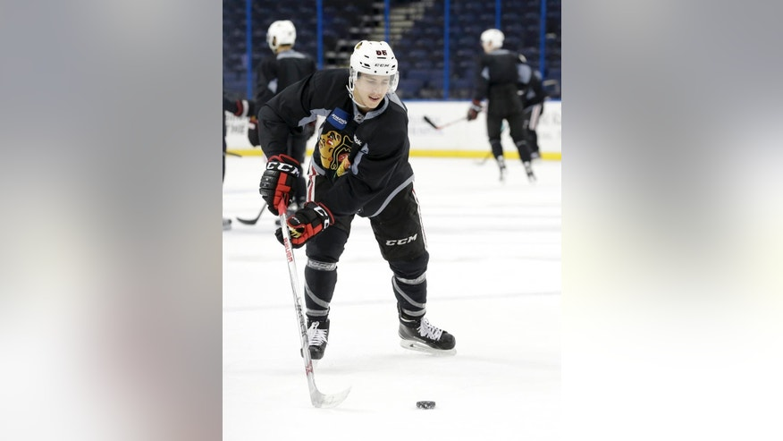 Chicago Blackhawks left wing Teuvo Teravainen shoots during practice at the NHL hockey Stanley Cup Final, Friday, June 5, 2015, in Tampa, Fla. The Blackhawks lead the best-of-seven games series against the Tampa Bay Lightning 1-0. Game 2 is scheduled for Saturday night. (AP Photo/Chris Carlson)