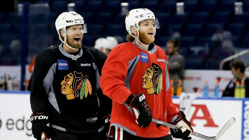 Chicago Blackhawks defenseman Kimmo Timonen, left, right wing Patrick Kane laugh during practice at the NHL hockey Stanley Cup Final, Friday, June 5, 2015, in Tampa, Fla. The Chicago Blackhawks lead the best-of-seven games series against the Tampa Bay Lightning 1-0. Game 2 is scheduled for Saturday night. (AP Photo/Chris Carlson)