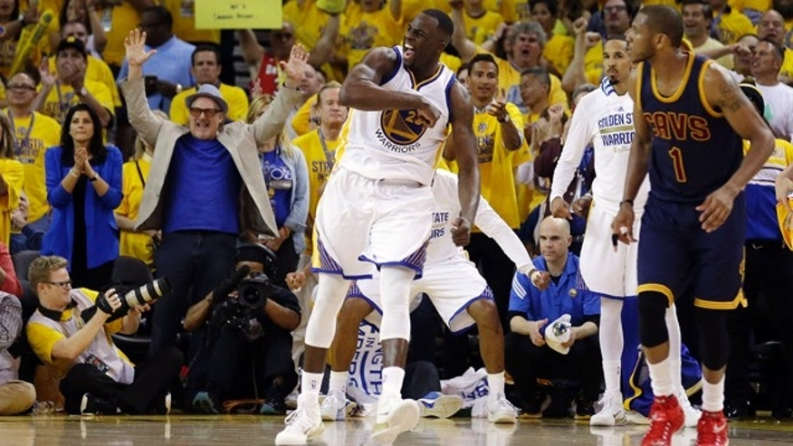 June 4, 2015: Golden State Warriors forward Draymond Green (23) celebrates next to Cleveland Cavaliers forward James Jones (1) during overtime of Game 1 of basketball's NBA Finals in Oakland, Calif. (AP Photo/Ben Margot)