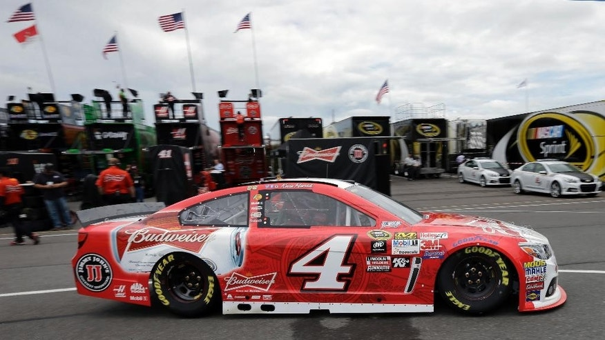 Kevin Harvick drives through the garage area at Pocono Raceway during practice for Sunday's NASCAR Sprint Cup Series auto race in Long Pond, Pa., Friday, June 5, 2015. (AP Photo/Mel Evans)