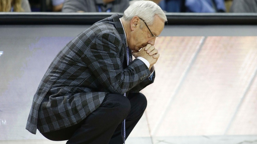 March 2015: North Carolina head coach Roy Williams bows his head during the second half of an NCAA college basketball game against Virginia in the semifinals of the Atlantic Coast Conference tournament in Greensboro, N.C.