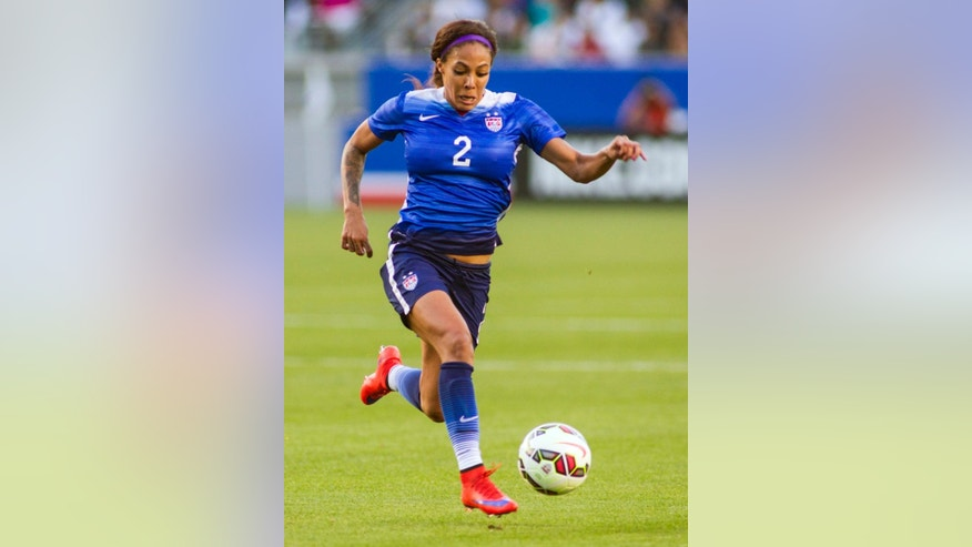 FILE - In this May 17, 2015, file photo, United States' Sydney Leroux dribbles the ball during a soccer friendly match against Mexico? in Carson, Calif. Leroux is a native of British Columbia and even played in the Canadian national team system. But at 15, and holding dual citizenship, she decided to move south in hopes of grabbing the attention of U.S. Soccer. Now Leroux is preparing to represent the United States in the Women's World Cup, in her native Canada. (AP Photo/Ringo H.W. Chiu, File)