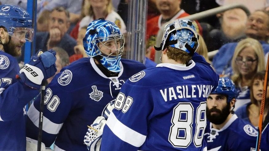 Tampa Bay Lightning goalie Ben Bishop, left, is replaced by goalie Andrei Vasilevskiy during the third period in Game 2 of the NHL hockey Stanley Cup Final against the Chicago Blackhawks in Tampa, Fla., Saturday, June 6, 2015.  (AP Photo/Chris O'Meara)