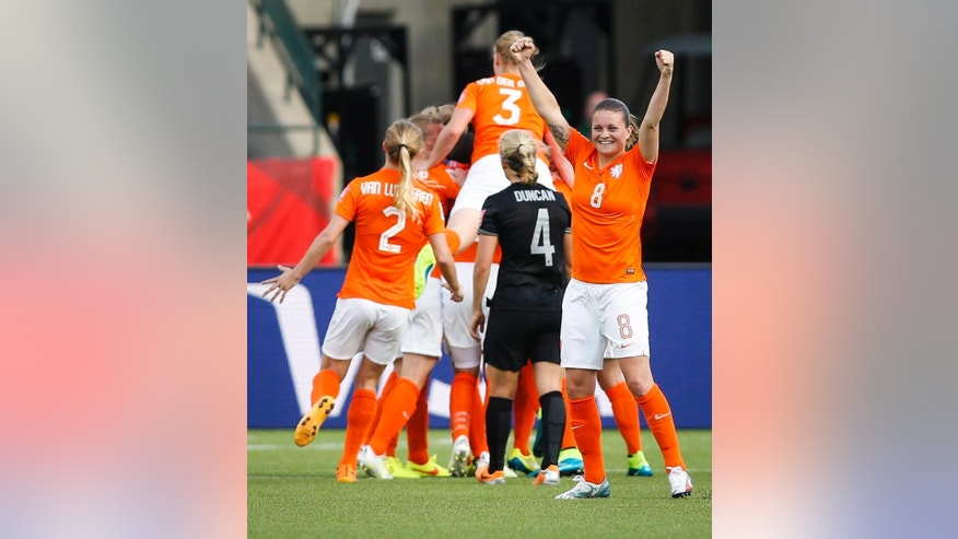 Netherlands' Sherida Spitse (8) celebrates her team's goal against New Zealand during a FIFA Women's World Cup soccer match in Edmonton, Alberta Saturday,  June 6, 2015. (Jeff McIntosh/The Canadian Press via AP)