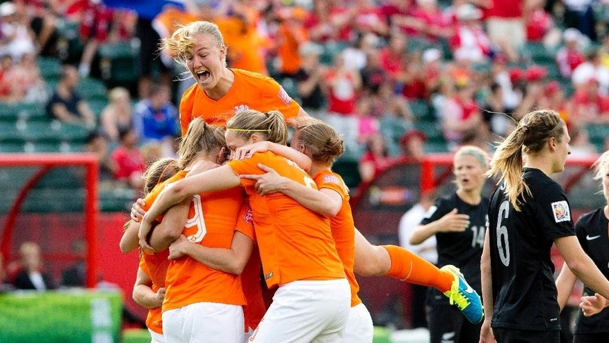 Netherlands players celebrate a goal against New Zealand during a FIFA Women's World Cup soccer match in Edmonton, Alberta Saturday,  June 6, 2015. (Jason Franson/The Canadian Press via AP)