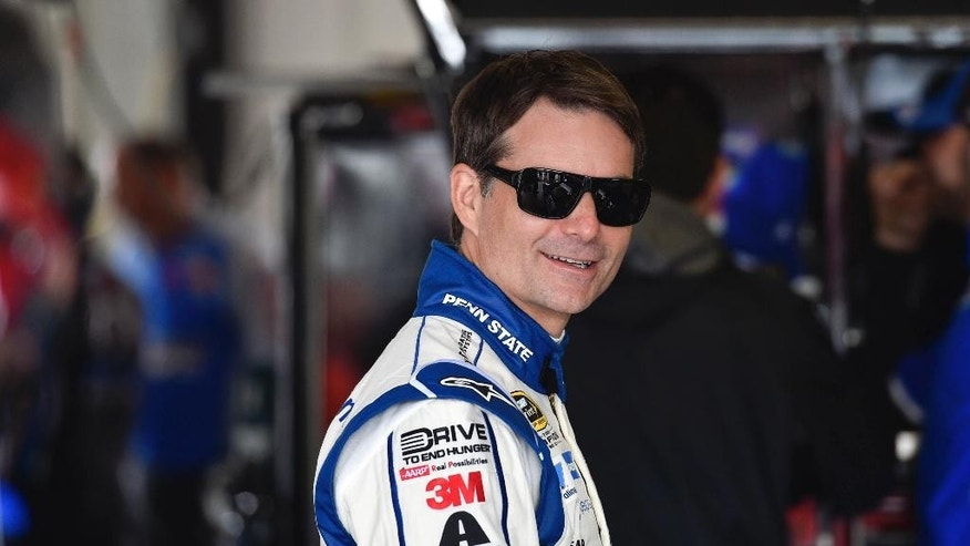 Jeff Gordon smiles in the garage area at Pocono Raceway during practice for Sunday's NASCAR Sprint Cup Series auto race in Long Pond, Pa., Friday, June 5, 2015. (AP Photo/Derik Hamilton)