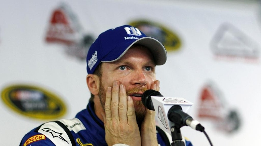 Dale Earnhardt Jr. pauses as he answers a question during an interview at Pocono Raceway in preparation for Sunday's NASCAR Sprint Cup Series auto race in Long Pond, Pa., Friday, June 5, 2015. (AP Photo/Mel Evans)