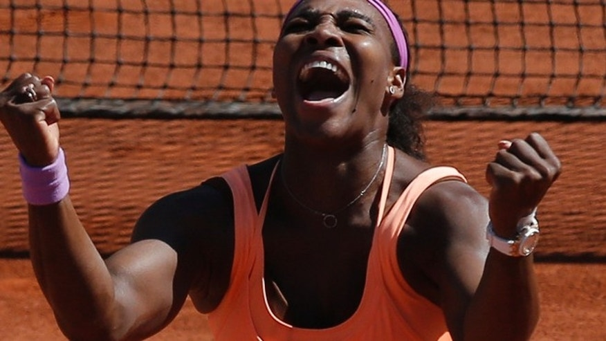 June 6, 2015: Serena Williams of the U.S. clenches her fists after defeating Lucie Safarova of the Czech Republic during their final match of the French Open tennis tournament at the Roland Garros stadium in Paris. (AP)