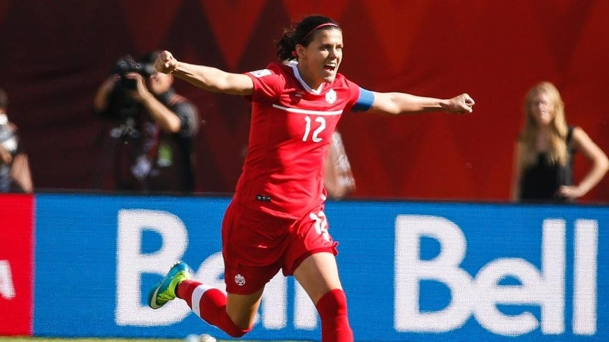 Canada's Christine Sinclair celebrates her game-winning stoppage-time penalty shot goal against China during a FIFA Women's World Cup soccer match in Edmonton, Alberta, Saturday, June 6, 2015.  (Jeff McIntosh/The Canadian Press via AP) MANDATORY CREDIT