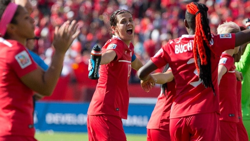 Canada's Christine Sinclair (12) celebrates her team's win over China during a FIFA Women's World Cup soccer match in Edmonton, Alberta, Saturday, June 6, 2015.  (Jason Franson/The Canadian Press via AP) MANDATORY CREDIT