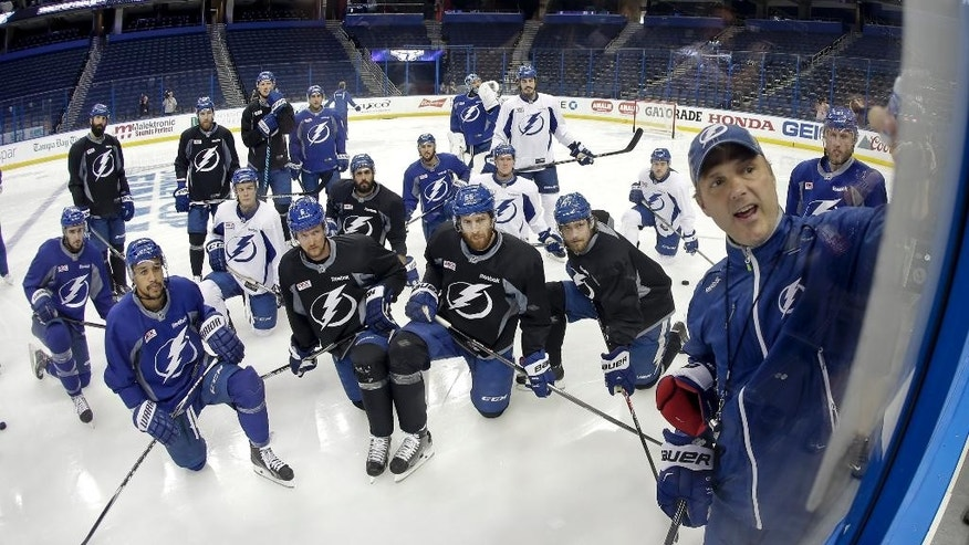 Tampa Bay Lightning head coach Jon Cooper talks to his team during practice at the NHL hockey Stanley Cup Final, Friday, June 5, 2015, in Tampa, Fla. The Chicago Blackhawks lead the best-of-seven games series 1-0. Game 2 is scheduled for Saturday night. (AP Photo/Chris Carlson)