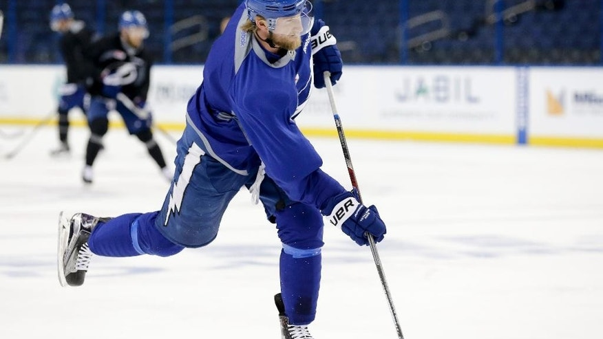 Tampa Bay Lightning center Steven Stamkos shoots during practice at the NHL hockey Stanley Cup Final, Friday, June 5, 2015, in Tampa, Fla. The Chicago Blackhawks lead the best-of-seven games series 1-0. Game 2 is scheduled for Saturday night. (AP Photo/Chris Carlson)