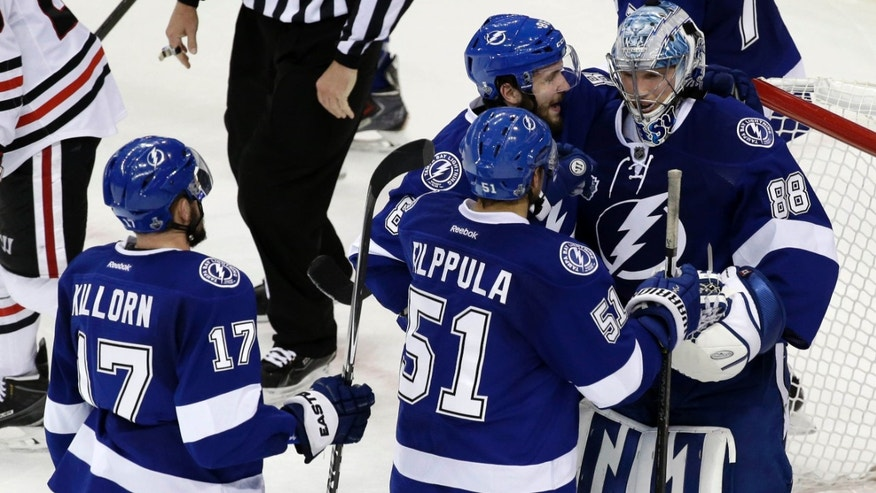 June 6, 2015: Tampa Bay Lightning players greet backup goalie Andrei Vasilevskiy after their win against the Chicago Blackhawks in Game 2 of the NHL hockey Stanley Cup Final.