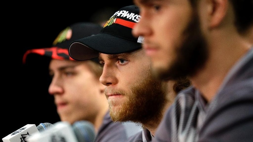 Chicago Blackhawks right wing Patrick Kane listens to a question during a news conference, Sunday, June 7, 2015, in Chicago. The Blackhawks and the Tampa Bay Lightning are tied 1-1 in the NHL hockey Stanley Cup Final after the Tampa Bay Lightning defeated the Chicago Blackhawks 4-3 in Game 2. Game 3 is scheduled for Monday. (AP Photo/Nam Y. Huh)