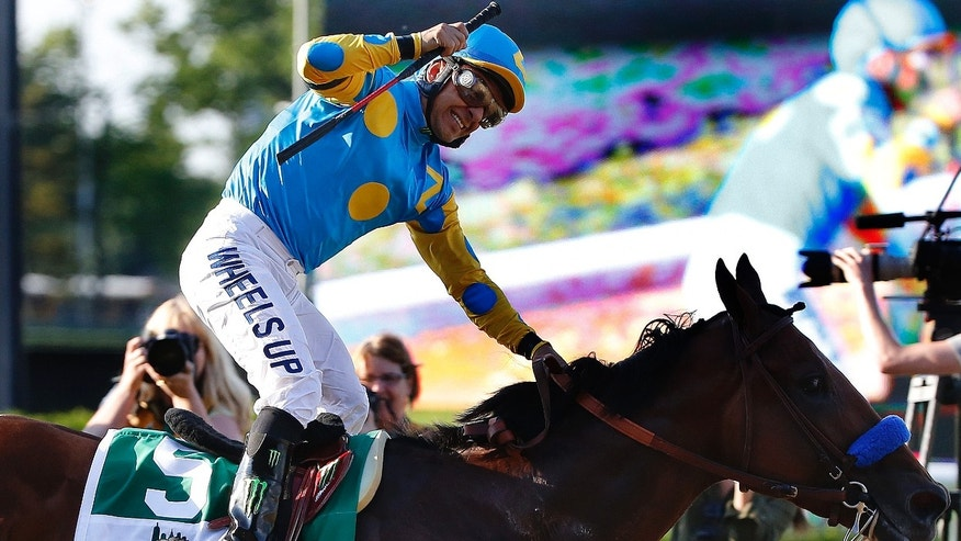 Victor Espinoza reacts after crossing the finish line with American Pharoah to win the 147th running of the Belmont Stakes horse race at Belmont Park, Saturday, June 6, 2015, in Elmont, N.Y. American Pharoah is the first horse to win the Triple Crown since Affirmed won it in 1978.  (AP Photo/Kathy Willens)