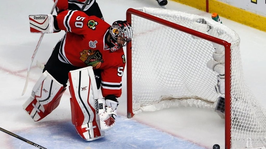 Chicago Blackhawks goalie Corey Crawford watches as a shot by Tampa Bay Lightning's Cedric Paquette finds the back of the net during the third period in Game 3 of the NHL hockey Stanley Cup Final on Monday, June 8, 2015, in Chicago. (AP Photo/Charles Rex Arbogast)
