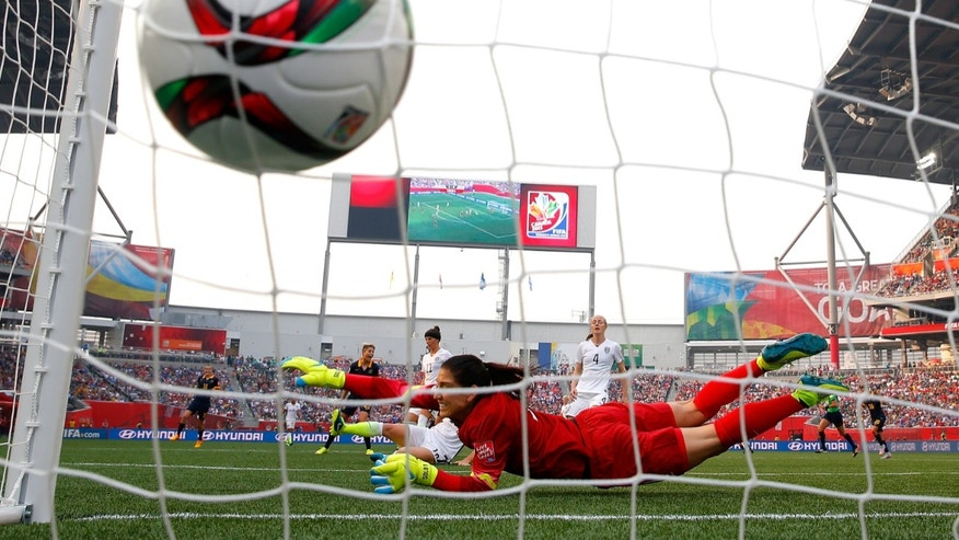 WINNIPEG, MB - JUNE 08:  Lisa De Vanna #11 of Australia scores a first half goal past a diving Hope Solo #1 of United States during the FIFA Women's World Cup 2015 Group D match at Winnipeg Stadium on June 8, 2015 in Winnipeg, Canada.  (Photo by Kevin C. Cox/Getty Images)