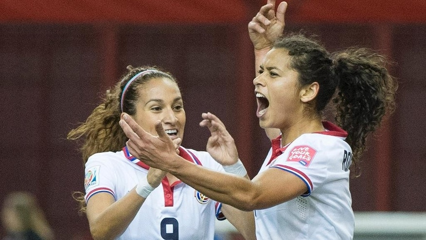Costa Rica's Raquel Rodriguez Cedeno, right, celebrates with teammate Carolina Venegas (9) after scoring against Spain during first half FIFA World Cup soccer action in Montreal, Canada, Tuesday, June 9, 2015.   (Graham Hughes/The Canadian Press via AP) MANDATORY CREDIT