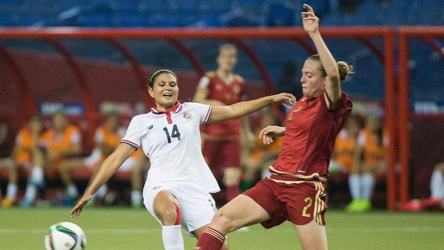 Costa Rica's Maria Barrantes, left, challenges Spain's Celia Jimenez (2) during the first half of a FIFA Women's World Cup soccer match Tuesday, June 9, 2015 in Montreal, Canada. (Graham Hughes/The Canadian Press via AP) MANDATORY CREDIT