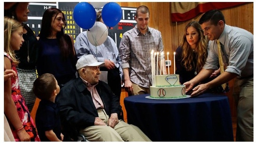 Baseball Hall of Famer Yogi Berra (c.) recently celebrated his 90th birthday. Granddaughter Lindsay Berra (second right) has led an online campaign to have help the WWII vet win the Congressional Medal of Freedom.(AP)