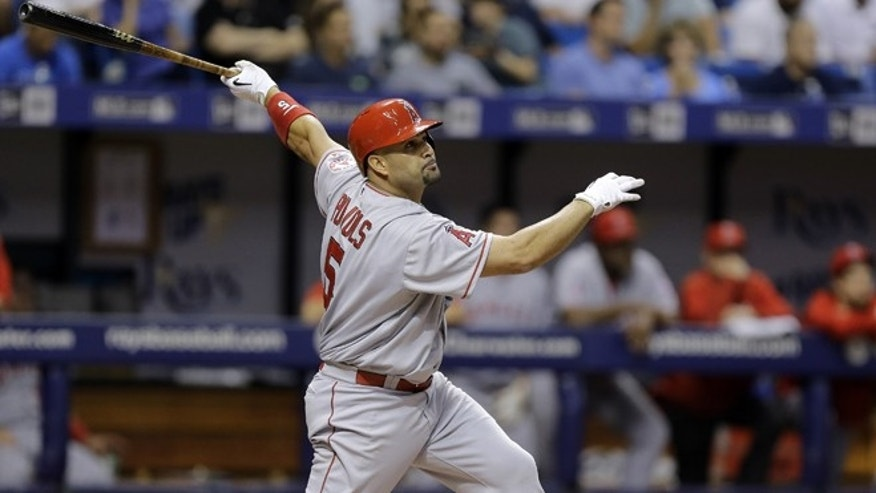 Los Angeles Angels' Albert Pujols follows the flight of his home run off Tampa Bay Rays starting pitcher Nathan Karns during the fifth inning of a baseball game Tuesday, June 9, 2015, in St. Petersburg, Fla.  (AP Photo/Chris O'Meara)