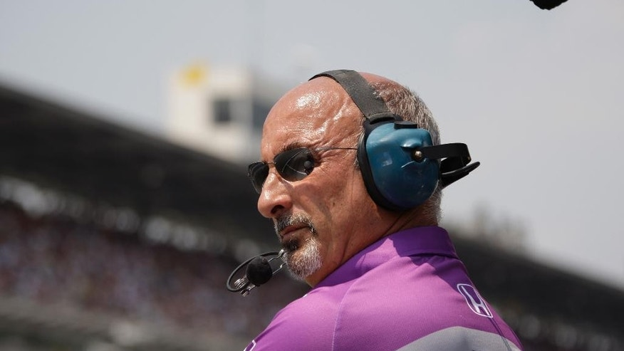 FILE - In this May 30, 2010, file photo, car owner Bobby Rahal watches the action during Indianapolis 500 auto race at the Indianapolis Motor Speedway in Indianapolis. Rahal loves going to the track these days to watch his son drive, and let team members do their jobs during races without any meddling from one of the team owners. (AP Photo/Darron Cummings, File)