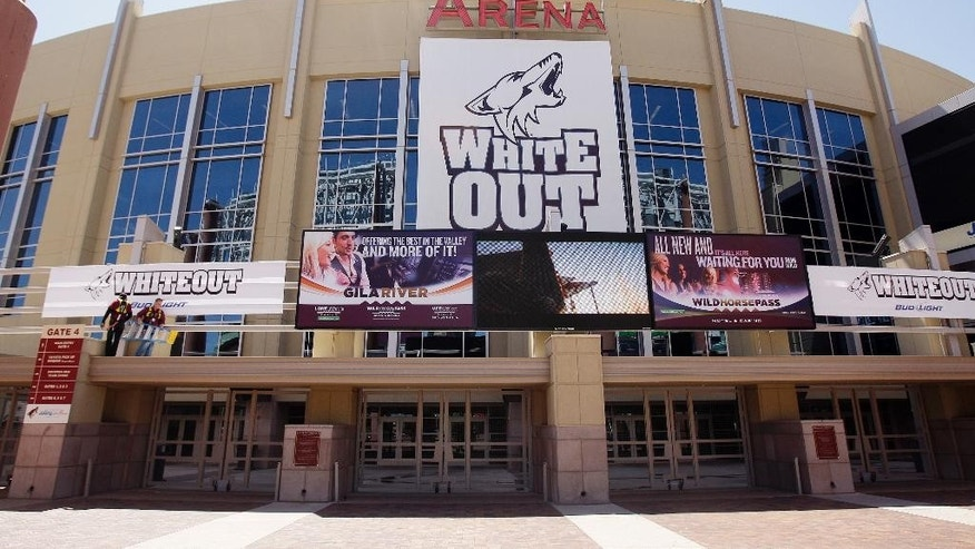 FILE - This April 12, 2010, file photo, shows an entrance to the Jobing.com Arena home of the Phoenix Coyotes NHL hockey playoff team in Glendale, Ariz. The city of Glendale has called for a special meeting on Wednesday, June 10, 2015, to determine whether to end an arena lease agreement with the Coyotes, further clouding the team's future in the desert. (AP Photo/Ross D. Franklin, File)