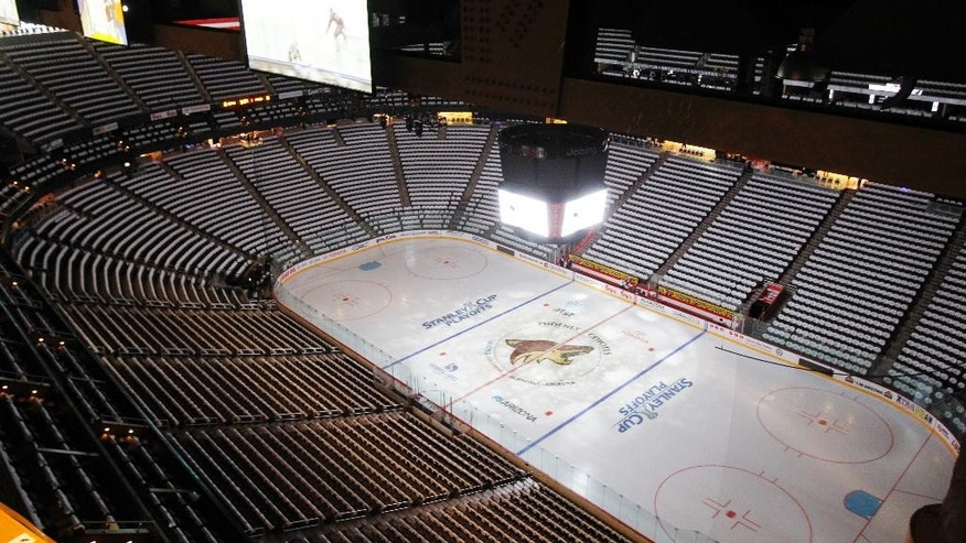 FILE - In this April 12, 2011, file photo, the Jobing.com Arena, home of the NHL hockey Phoenix Coyotes, sits empty before a Stanley Cup playoff game in Glendale, Ariz.   The city of Glendale has called for a special meeting on Wednesday, June 10, 2015, to determine whether to end an arena lease agreement with the Coyotes, further clouding the team's future in the desert.(AP Photo/Ross D. Franklin)