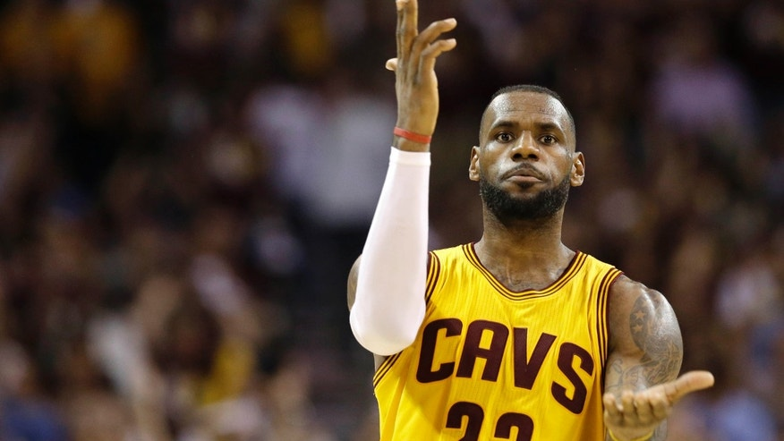 June 9, 2015: Cleveland Cavaliers forward LeBron James (23) celebrates a play against the Golden State Warriors during the second half of Game 3 of basketball's NBA Finals in Cleveland.