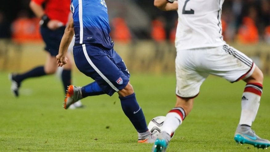 United States' Bobby Woods scores his side's second goal during the soccer friendly match between Germany and the United States in Cologne, western Germany, Wednesday, June 10, 2015. (AP Photo/Frank Augstein)