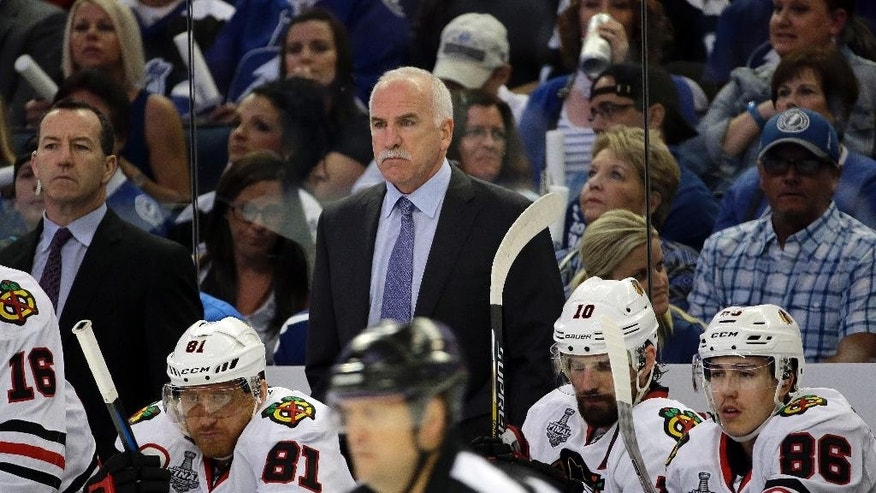 Chicago Blackhawks head coach Joel Quenneville watches during the first period in Game 2 of the NHL hockey Stanley Cup Final against the Tampa Bay Lightning in Tampa, Fla., Saturday, June 6, 2015.  (AP Photo/Chris O'Meara)