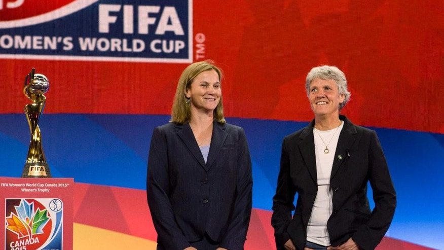 FILE - In this Dec. 6, 2014, file photo, national team soccer coaches, from left, United States coach Jill Ellis and Sweden's coach Pia Sundhage, pose for a photograph in Gatineau, Quebec, after the FIFA Women's World Cup draw. The two teams meet on Friday, June 12, 2015, in the opening round of the World Cup in Canada.(AP Photo/The Canadian Press, Fred Chartrand)
