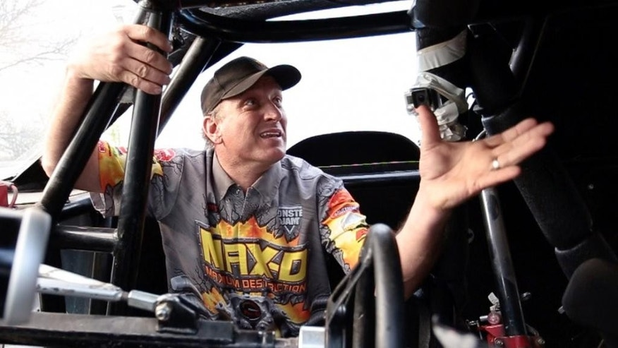 In this image taken on May 7, 2015, and provided by Feld Motor Sports, Tom Meents sits in the cabin of his monster truck in Paxton, Ill. Meents will attempt to make the Guinness Book of World Records when he tries to land a full front flip in a truck at the Monster Jam, Saturday night, June 13, 2015, at MetLife Stadium in East Rutherford, N.J. (Feld Motor Sports via AP)