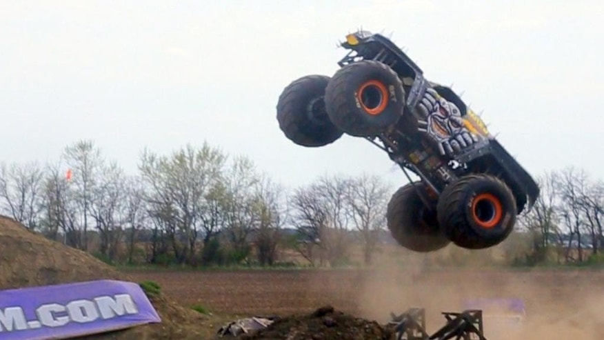In this image taken from video on May 7, 2015, and provided by Feld Motor Sports, Tom Meents drives his truck over his custom ramp in Paxton, Ill. Meents will attempt to make the Guinness Book of World Records when he tries to land a full front flip in a trucke at the Monster Jam, Saturday night, June 13, 2015, at MetLife Stadium in East Rutherford, N.J. (Feld Motor Sports via AP)