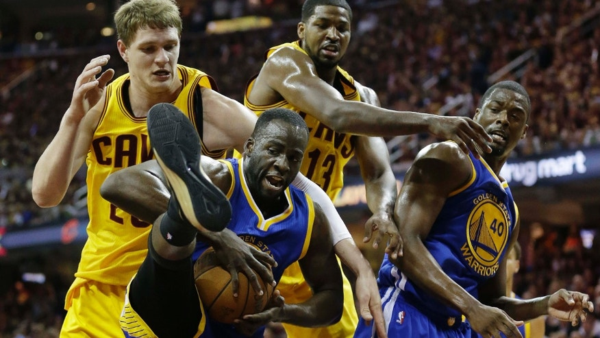 June 11, 2015: Golden State Warriors forward Draymond Green (23) comes up with a rebound next to teammate Harrison Barnes and Cleveland Cavaliers center Timofey Mozgov (20), top, left, and center Tristan Thompson (13), top right, forward Harrison Barnes (40) go up for a rebound during the first half of Game 4 of basketball's NBA Finals in Cleveland.